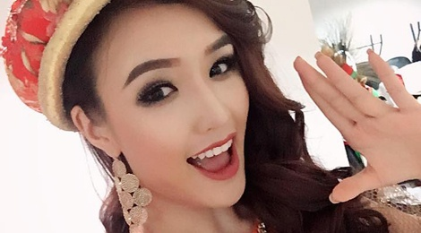 Phuong Chi lot top 10 Nu hoang Du lich Quoc te hinh anh