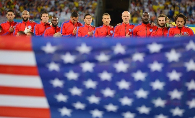 the-usmnt-sings-the-anthem-behind-the-american-flag-before-their-ghana-game.